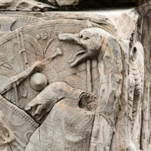 Detail of captured armor represented in relief sculpture from the pedestal of the Column of Trajan. The draco standard is most prominent, against a background of oval shields, battle axes, and a shirt of chain mail. RBU2013.2082