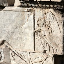 Detail of one of the winged victories on the southeast side of the pedestal supporting the Column of Trajan.