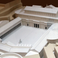 A new model in the Museo della Civiltà Romana restores Trajan's forum based on the most recent excavations in central Rome that have taken place since the year 2000.  In the foreground, the open plaza of the forum dominates this view.  The Basilica Ulpia, with its two exedrae, closes off the northwest side of the forum complex.  Behind the Basilica the top of the Column of Trajan is visible.