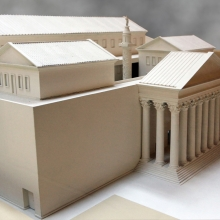 A new model in the Museo della Civiltà Romana shows the north entrance to the Forum of Trajan.  A monumental octastyle porch opens on to a small courtyard which surrounds the Column of Trajan.  Multi-storied libraries face the Column on the northeast (foreground) and southwest sides.  In the background the clerestory level of the Basilica Ulpia is visible.