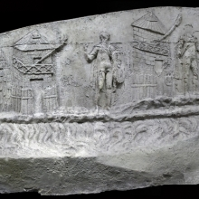 Scene 1/I: Roman sentries are depicted standing guard along the Roman side of the Danube river.