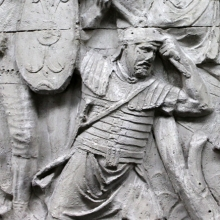 "Scene 127/CXXVII (detail): Close view of the legionary soldier swinging an axe.  This tool could be a common ""securis,"" rather than a standard military-issue ""dolabra.""