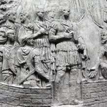 Scene 141/CXLI: A closer view of Trajan's final appearance on the Column.  Prominent Dacians (pileati) make an appeal to the emperor. 
