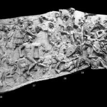 "Scene 24/XXIV (right): The first major battle scene.  Note the presence of Jupiter Tonans in the upper right of the scene.  His presence has given the name of scene 24 as the ""Battle in the Thunderstorm."" Compare Cichorius Plate XVII-XIX  (Scene 24); Casts nos. 55-62 in the Museo della Civiltà Romana. Ref: RBU2011.6977comp24. (Composite from seven photographs)."