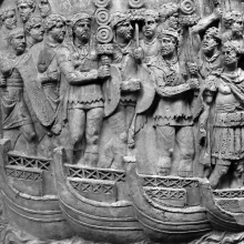 Scene 48/XLVIII: Standard-bearers and an officer lead a line of troops across a pontoon bridge.