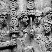 Scene 48/XLVIII: Standard-bearers lead a line of troops across a pontoon bridge.