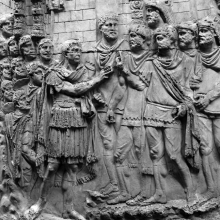 Scene 51/LI: Trajan, with his retinue of reinforcement troops behind him, meets a group of auxiliaries and legionaries. He wears a cuirass and splendid fringed paludamentum. A fortified camp fills the background. From casts 127-128, now in the Museo della Civiltà Romana, Rome. Compare Cichorius Pl. XXXVII, scene 51 and Coarelli Pl. 53.  RBU2011.7107.