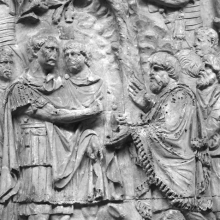 "Scene 52/LI: In the midst of a forestry and camp-building scene, Trajan receives  Dacian ambassadors, whose fringed garments draw focus to their presence before the emperor.  These are Dacian <i>Comati</i> ""proposing terms that the emperor presumably is rejecting"" (Lepper and Frere 1988: 100).  In the foreground legionaries excavate trenches, removing soil in woven baskets.