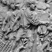 Scene 66/LXVI: A soldier fighting on the Roman side holds a sling at ready in his hand.  Extra ammunition hangs from his chest.