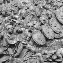 Scenes 70/LXX:  Romans bringing up the rear) and their allies (the former shown with oval shields and bare chests- clibanarii- attack the Dacians, stepping over the bodies of the fallen enemy in the foreground.From casts 177-178, now in the Museo della Civiltà Romana, Rome. Compare Cichorius Pl. L, scene 70 and Coarelli Pl. 78.  Ref: RBU2011.7177.