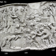 Scene 73/LXXIII (composite image): Trajan addresses his men within the walls of the camp (adlocutio).  In the foreground soldiers work with their axes (dolabrae) on rough timber.
