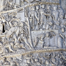 Scenes 72-73/LXXII-LXXIII:  There is a stark contrast between the fight raging in Scene 72 (left) and the camp construction scene that dominates Scene 73.  Note the slender tree that acts as a divider.  Trajan, in the midst of three officers, dominates the latter scene as he stands on the ramparts and supervises the project.