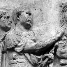 Scene 54/LIV: Detail: Trajan addresses his troops (adlocutio).  From cast 135, now in the Museo della Civiltà Romana, Rome. Compare Cichorius Pl. XXXIX, scene 54 and Coarelli Pl. 56.  RBU2011.7121.