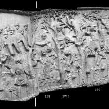 "Scenes 55/LV and 56/LVI.  The large tree on the right border of cast 137 was regarded by Cichorius as a scene division, considered ""plausible"" by Lepper and Frere (1988: 101). Scene 55: Roman soldiers begin their advance up a hill.Scene 56: In rough terrain, Roman legionaries clear their way through a forest. Note the roadbed visible under the feet of the soldiers in cast 138. The Dacian heads on the far right of the scene may indicate a captured Dacian fort seen in the background of casts 139 and 140.From casts 137-140, now in the Museo della Civiltà Romana, Rome. Compare Cichorius Pls. XXXIX-XL, scenes 55-56 and Coarelli Pls. 57-58.  RBU2011.7122-composite."