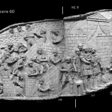 Scenes 60/LX and 61/LXI: Left, Roman legionaries construct a camp as fellow soldiers in the hills beyond (top left) keep guard.  On the right (61), within a similar, now-completed fort, Trajan, with four officers (two on the left are wearing helmets) receives a high-born Dacian who has placed his shield on the ground in front of him.  From casts 145-148, now in the Museo della Civiltà Romana, Rome. Compare Cichorius Pl. XLII, scenes 60-61 and Coarelli Pls. 61-2.  RBU2011.7130-composite.