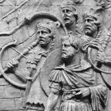 Scene 61/LXI: Detail of the trumpeters and standard-bearers who witness a Dacian ambassador who presents himself to Trajan.  In the foreground stands a legate. 