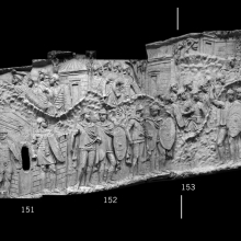 Scenes 62/LXII and 63/LXIII.  Draft animals (oxen and mules) appear on the left (cast 149) towards a fortification that protects a large tent - headquarters? (casts 150-151).  Legionaries are stationed outside of the fortress walls.  More legionaries and auxiliaries head into mountainous terrain (casts 152-154).  Windowless cylindrical buildings with conical roofs and perhaps skylights create the background: Dacian tombs?  Temples? cf. Lepper/Frere 1988: 104.  Within this mountain setting the emperor Trajan consults his officers (cast 155).