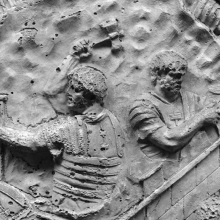 Scene 65/LXV (detail): Two legionaries at work on fortifications.