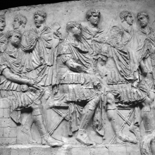 Scene 6/VI: Trajan reviews his troops while seated on a high tribunal, flanked by two high-ranking officers.   Cast in the Museo della Civilta' Romana, Rome. Compare: Cichorius, Pl. IX, scene 6; Coarelli (2000) Pl. 7. Ref: RBU2011.6918