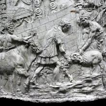 Scene 8/VIII: Detail of the sacrificial animals being led to sacrifice (Suovetaurilia).  A Roman encampment lies behind the wall. Cast in the Museo della Civilta' Romana, Rome. Ref: RBU2011.6929