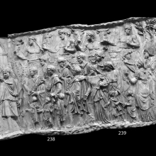 "Scene 91/XCI: Trajan performs a sacrifice at an altar (cast 237), pouring a libation from his patera as he is attended by an aulos player and camillus.  He is accompanied by both togate Romans and Dacians, including a number of children who stand in the foreground.  Along the top of the scene victimarii lead bulls to sacrifice.  Note the series of individual altars at which the separate sacrifices will take place. ""The scene is said to have taken place on the battlefield of Tapae, where an annual ceremony was held"" (Coarelli 2000: 151).
