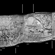 Scenes 80/LXXX-83/LXXXIII: Composite Image. Trajan and his men cross from Italy onto the western coast of the Balkan Peninsula. On casts 212-213 Trajan's fleet is greeted with a sacrifice that takes place in front of an altar.  The emperor is welcomed in front of an open-air portico that encloses a temple.  The harbor scene continues across casts 217-218, and the emperor is excorted from town in the profectio of casts 219-220.  Cichorius's scene divisions here have been called into question; much of what we see appears to belong to a continuous event that took place upon his landing on the Dalmation coast, perhaps at Zara (although a number of different locales have been proposed).