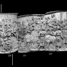 """Scenes 84/LXXXIV-85/LXXXV: The arch on the left presumably indicates the exit point from the harbor city of the previous scene.  Men with garlands and children move in a procession towards the right in casts 219-220.  They accompany Trajan who strides ahead with a flowing cape (at the break between casts 220-221). Another group waits to welcome the emperor on the far right (casts 223-224) while four bulls (two in the foreground and two in the background) are adorned and readied for sacrifice in front of two garlanded altars. On the far right we see a pair of standards with hands at the top (""""maniple"""" standards) and a pair of soldiers peering over the walls of a fortress. From casts 219 - 224, now in the Museo della Civiltà Romana, Rome. Compare Cichorius Pls. LXI-LXII scenes 83-85 and Coarelli Pls. 98-99.  RBU2011.8092-composite."""