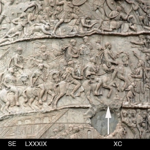 Scenes 89-90/LXXXIX_XC: at the head of a mounted column, Trajan (arrow) is welcomed  by local Dacians.