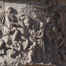"Scene 90/XC: Trajan, at the head of a group of horsemen, arrives in Dacian territory that has been ""pacified.""  He rides at the lead, focus achieved by placing his head against a plain background.  Dacian men and their children reach out to him with gestures of welcome.  From the Column in situ.  Compare Cichorius Pl. LXV scene 90 and Coarelli Pl. 105.  RBU2013.3811."