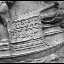 Scene 82/LXXXII: Roman sailors at work on a warship in the harbor. On the right, a detail of the <em>rostrum</em>, or ramming beak of a Roman warship's prow.  Here the <em>rostrum</em> includes three separate protruding elements (either connected by fins or independent of one another; it id not clear from the representation).  Note that aft of the beak, the ship is decorated with the depiction of a miniature Roman warship. From casts 217-218, now in the Museo della Civiltà Romana, Rome. Compare Cichorius Pl. LXI (Scene 82) and Coarelli Pl. 96.  RBU 2011.8083.